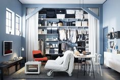 IKEA shelves, bed+sofa combined, max space up to ceiling.
