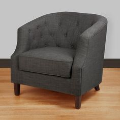 Bring extra seating into your room with this stylish tub chair from Ansley. Featuring charcoal gray upholstery, button tufting, and cappuccino-finished legs, this attractive chair adds sophistication to any seating area in your home.