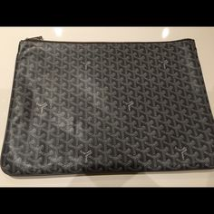 Goyard look a like Large grey Goyard pouch extremely good quality. Smoke free home and only used twice for documents/computer/trendy oversized look. Price reflects authenticity but is a gorgeous addition to any collection. Selling because my bag collection is getting out of control although not dying to sell it. Have brown Goyard box. Goyard Bags Clutches & Wristlets