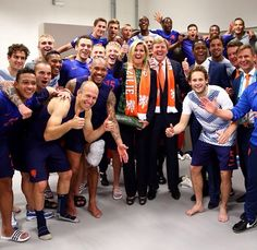 King and Queen from Netherlands with their national football team