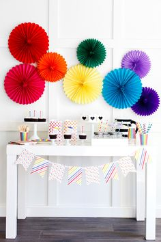 Tissue Paper Fans are an easy way to create a focal point or backdrop for any celebration. This simple + colorful set up is fun and stress-free. #babyeinstein #firstbirthday