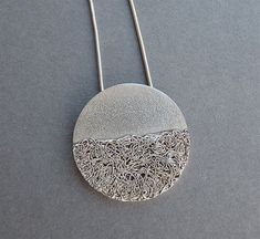 This modern and unique pendant is completely hand fabricated in sterling silver 925 and 99.9 fine silver wire. It has been textured, partially oxidized and polished to a bright and shiny finish. It…MoreMore #SilverJewelry