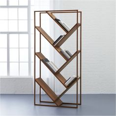 minimalist slant. Miron Lior's inventive design angles to add interest to any size space. Open solid-teak frame braces seven slanted shelves in rich wood tones and active grain. Alternating angles create an airy, uncluttered silhouette to beautifully br