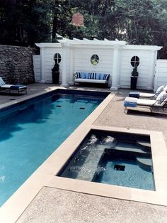Built In Benches Offer Easy Seating For This Backyard Pool