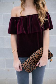 Velvet Off the Shoulder Top | Twenties Girl Style Velvet off the shoulder ruffle top, grey skinny jeans and a leopard clutch