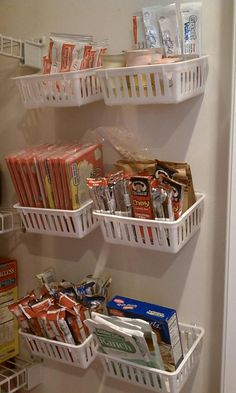 Pantry organizing. Plastic trays from walmart, put up with command hooks. Works great!