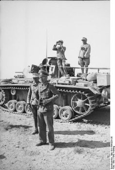 While serving with the Afrika Korps, Major-General Von Bismarck, watches his forces next to a Panzer 3 during 1942