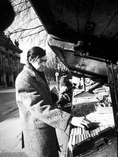 Premium Photographic Print: Author Julio Cortazar Looking Bookstalls on Street : 24x18in