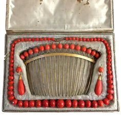 Faceted coral necklace, pair of earrings, and hair comb, in original red leather box. Probably Italian c1780-1800. From P & R Szuhay