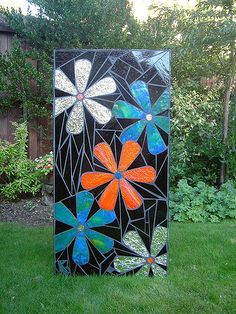 Mosaic garden art (62 x 123cm / 2' x 4'). Designed and handmade using stained glass.