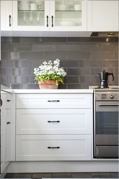 Perfect for entertaining, this country-style kitchen renovation in Mooroolbark features clever storage ideas and layers of white to brighten the space. Grey Kitchen Cabinets, Kitchen Doors, New Kitchen, Kitchen Dining, Kitchen Ideas, Country Kitchen Renovation, Kitchen Remodel, Classic White Kitchen, Quality Kitchens