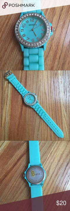 Geneva Silicone Watch This is a mint green, Geneva watch with a silicone band. The camera was unable to capture the true color.  It features cubic zirconium diamonds around the clock. The clock dial measures approximately 1.5 inches wide. The length of the watch is approximately 9.5 inches long. It has never been worn as evidenced by the unpunched wrist band, stickers on the back, and tab on the crown.  The battery is in working condition. Reasonable offers considered. Geneva Accessories…