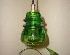 We all love the look of vintage Railroad telegraph glass insulators converted into custom lighting but are very limited to colors since so many of the beautiful colors of glass makes them rare and very expensive.    This ad is for One Custom Colored Hemingray 45 in Violet . With your color choice of Hardware (Black, Brass, White,) and ceiling canopy color (Black , Brass,, White) and wiring that is approx 5ft long so youll have plenty to adjust in (Black Round wire, Black twisted rayon wire…