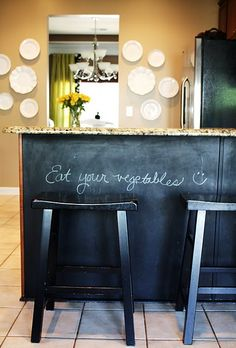 Chalkboard under the breakfast bar, and those white plates.