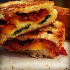 Jalapeno popper grilled cheese -- cheddar, jack, grilled jalapenos, bacon, and cream cheese between slices of buttery bread. Whats not to love?