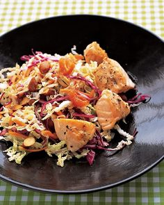 Asian Salad with Salmon - Martha Stewart Recipes - Sauteed Salmon, Shredded Napa Cabbage, Shredded Carrots, Sliced Red Onion, Sliced Almonds, Chopped Dried Apricots with Classic Cole Slaw Dressing Mixed with a Bit of Soy Sauce, Topped with Black and White Sesame Seeds