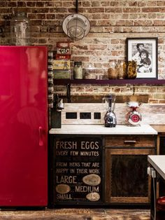 Gaby Dellal, London home renovation, red refrigerator, brick wall, remodelista Love the exposed brick Brick Wall Kitchen, Red Kitchen, Rustic Kitchen, Kitchen Dining, Kitchen Decor, Kitchen Colors, Nice Kitchen, Kitchen Ideas, Kitchen Industrial
