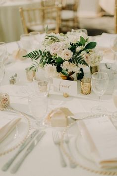 This floral centerpiece with greenery goes beautifully with these gold detailed charger plates White And Gold Wedding Themes, Champagne Wedding Themes, Wedding Reception, Flower Centerpieces, Wedding Centerpieces, Floral Wedding, Wedding Flowers, Wedding Table Settings, Reception Decorations