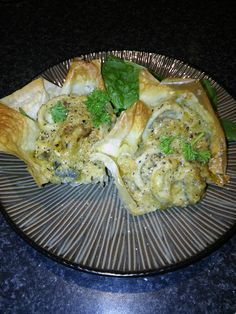 Phyllo pastry pockets filled with creamy garlic and lemon sauce snails, calamari and mussels