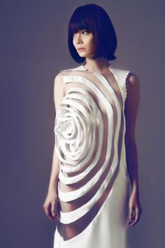 Sculptural Fashion - white dress with interesting use on transparency and dimensional layers to create the illusion of floating patterns and texture
