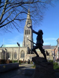 Leicester Cathedral with the statue of King Richard III in the gardens.