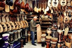 Wandering Down Galip Dede Caddesi    Hear the sounds emerge from the music shops, everything from electric guitars and drum kits to traditional instruments like saz and ney on Galip Dede Caddesi.    Photo Caption: Musical instruments in a music shop on Galip Dede Caddesi in Istanbul, Turkey    Photo by ghirigoribaumann/Flickr.com