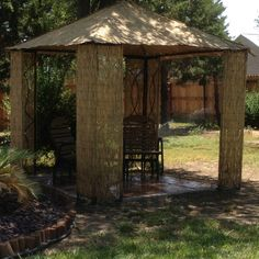 Garden gazebo transformed into Tikki Hut using bamboo fencing. (cheaper than replacing cloth top torn in Kansas wind)