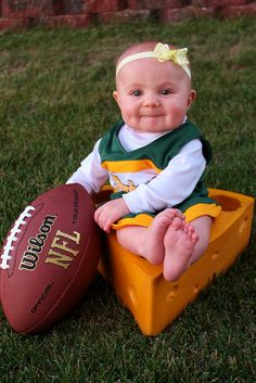 Baby Packer picture idea :)  Cheesehead, cheer uniform and football.