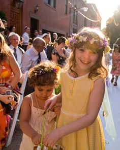 Summery flower girls wearing floral crowns
