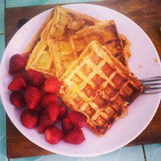 Home made waffle with honey and strawberries