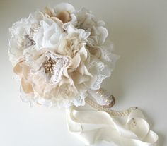 Hey, I found this really awesome Etsy listing at http://www.etsy.com/listing/111041064/fabric-flower-bouquet-vintage-weddings