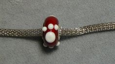 european bead glass red and white paw big hole cat by TamiOconnell