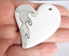 Love the simplicity of this.  Heart Black dots and White ceramic pendent  OOAK by ile1974, €16.00