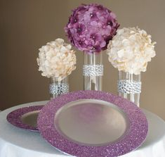 Amethyst Purple Glitter Charger Plate.  This is just a picture but it would be really easy to make with a cheap plastic charger plate and lots of glitter.  Just make sure to spray with a clear coat to keep the glitter on the plate and off the table.