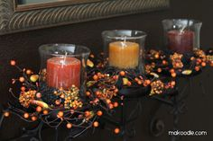 Fall-Candles (3)  from: makoodle.com  Think of the possibilities! Use dried white beans and red candles for Christmas. Use dried peas and pastel colored candles for Easter.