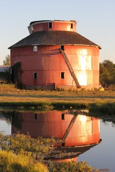 Saginaw, Missouri round barn at sunset ..rh