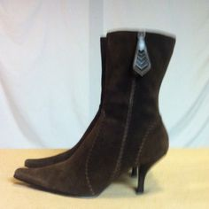 Nine West Brown Suede Pointed Booties These booties have been gently worn and are in excellent condition. The heel height of them is 3 inches and no platform. Nine West Shoes Ankle Boots & Booties