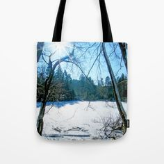MM - Sun over a snowy pond Tote Bag That's a snow-covered pond in the forest. Some tracks of animals are leading over it. It was a wonderful sunny, but cold day in winter.   Nature, landscape, tree, shadows, sunrays, sunbeams, white, blue