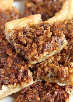 Pecan Pie Bars Pecan pie in a bite size bar! Crescent roll dough makes this pecan bar recipe simple and quick to prepare.Pecan pie in a bite size bar! Crescent roll dough makes this pecan bar recipe simple and quick to prepare. Pecan Recipes, Sweet Recipes, Cooking Recipes, Bar Recipes, Quick Dessert Recipes, Fudge Recipes, Detox Recipes, Recipies, Just Desserts