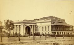 A photograph of the Byculla Club, Bombay from the 'Vibart Collection of Views in South India' taken by an unknown photographer about 1855.The Byculla Club opened in 1833, the first of Bombay's residential clubs serving the British residents of the prosperous and elegant suburb of Byculla. It was turned into a hospital during the First World War and was eventually sold in the 1920s.