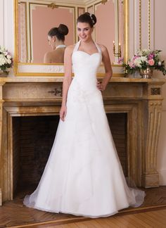 Sweetheart wedding dress style 6005- This organza sweetheart asymmetrically draped drop waist flows into an  A-line skirt. Beaded lace and organza petals adorn the hip. There is a  beautiful and delicate flutter of organza on the front of the skirt. The  gown features a chapel length train and organza buttons over the  zipper.
