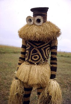 "Africa | Minganji masquerader, near Gungu, DR Congo © Eliot Elisofon, 1951 | ""Although the Minganji face masks make an appearance at a wide variety of occasions (such as the investiture ritual of a local chief, or the construction of a new chief's residence), their primary role is as guardian of the initiation encampement. The Minganji masks, other than the Gitenga mask, embody death, uncertainty, and darkness."""