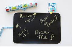 http://www.samandbellie.com/category_s/126.htm Lolly Chalkmat is the only eco-friendly PVC free chalkboard! Use it as a placemat or flip it over as a chalkboard for your artistic child.
