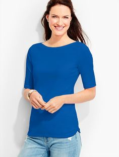 Likes: elbow length sleeve, NOT a crew neck, longer length, shaped hem.  Elevated version of the basic tee and everyone should have an assortment in a variety of colors.