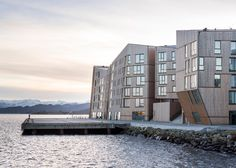 "Faceted waterfront housing in Norway conceived as ""a mountain range of wood"".  (via Gau Paris)"