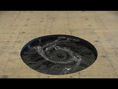 Anish Kapoor's Perpetual Black Water Whirlpool Installed in the Floor of a Former Movie Theater in Italy | Colossal