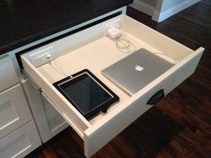 Contemporary Kitchen: TIP- Wire your drawers. Do you need your technology while you cook, perhaps to look up recipes or cooking hints, make cooking notes, play music or make diary entries? A powered drawer can keep your electronics off the counter and away from cooking mess and moisture and can charge them at the same time.: