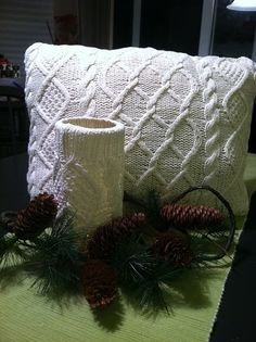 cable knit sweaters made into pillow and candle holder