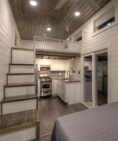 The storage stairs have a pull-out table and stools, and lead up to a bedroom loft.