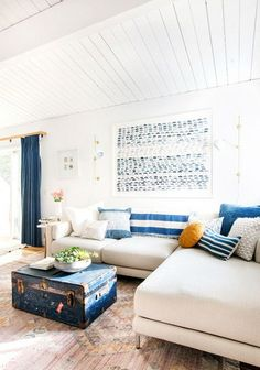 Blue and white together make for a classic combination in a Cali-cool living room with nautical influences. Throwing in lots of textural pillows, indigo artwork, and a deep blue vintage trunk as a...